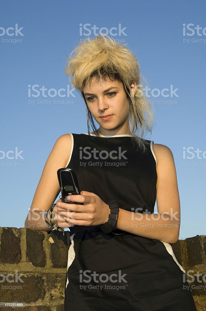 Young Woman texting on Mobile Phone royalty-free stock photo