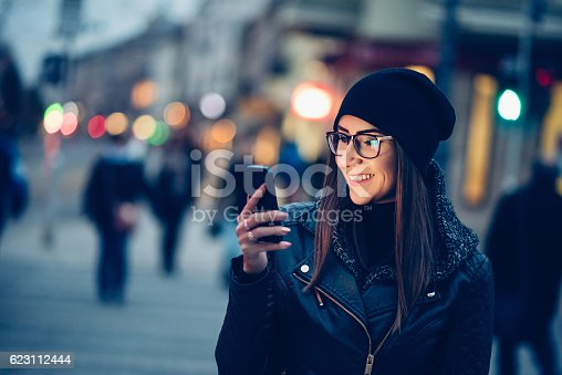 660640502 istock photo Young woman texting on the phone 623112444