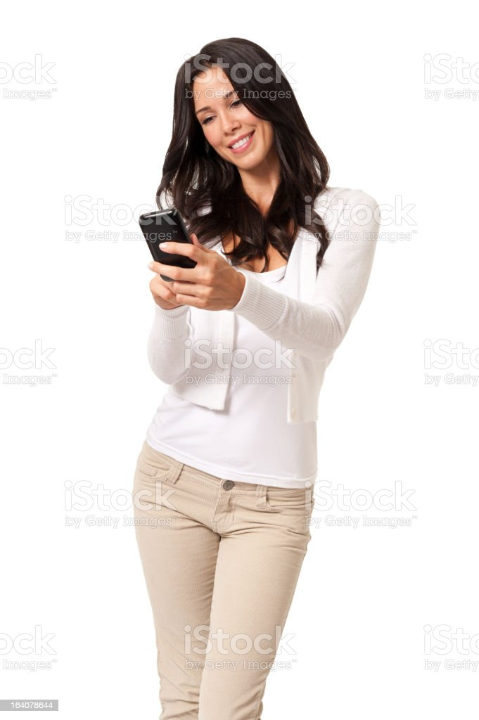 Young Woman Texting with Mobile Phone Isolated on White Background royalty-free stock photo
