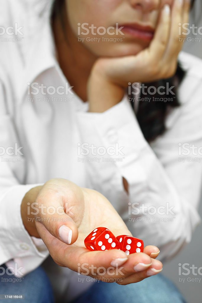 Young woman thinking about the game royalty-free stock photo