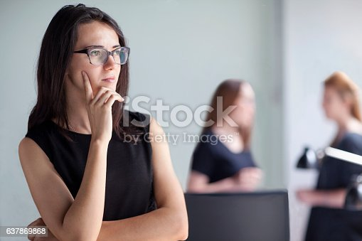 istock Young woman thinking in business office 637869868