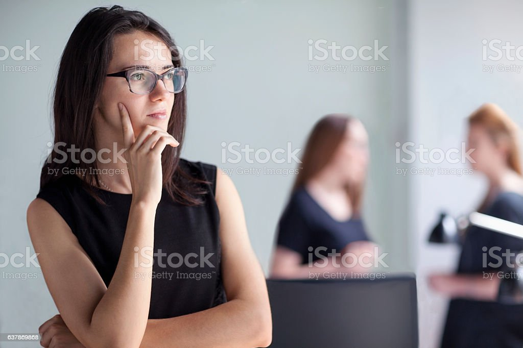 Young woman thinking in business office stock photo