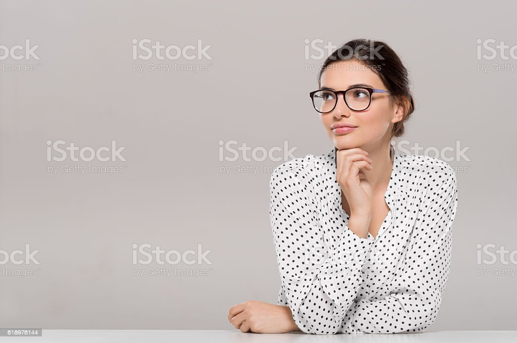 Young woman thinking stock photo