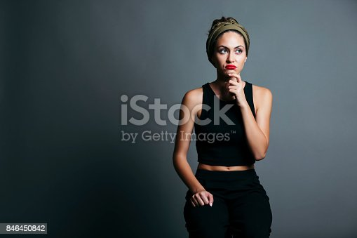 618976144istockphoto Young woman thinking 846450842
