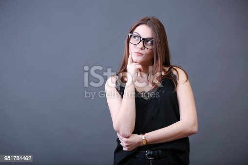 618976144istockphoto Young woman thinking 951784462