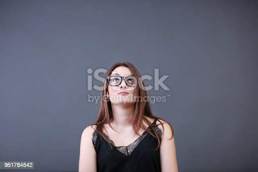 618976144istockphoto Young woman thinking 951784542