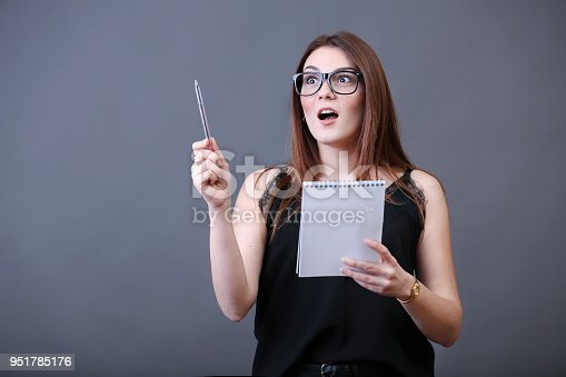 618976144istockphoto Young woman thinking 951785176