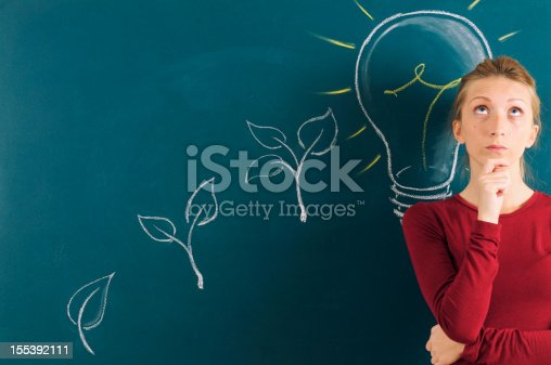184960675 istock photo Young Woman Thinking to Green Energy 155392111
