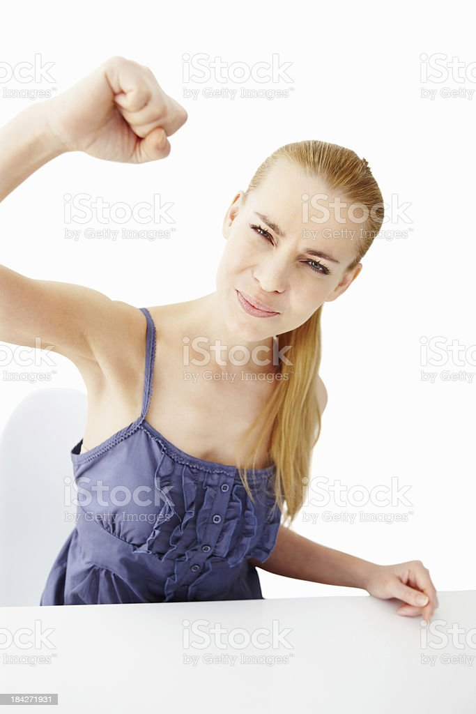 Young woman threatening with fist royalty-free stock photo
