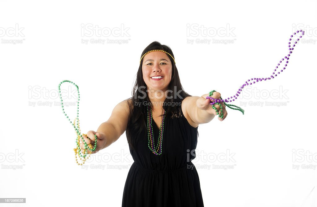 Young Woman Throwing Mardi Gras Beads stock photo