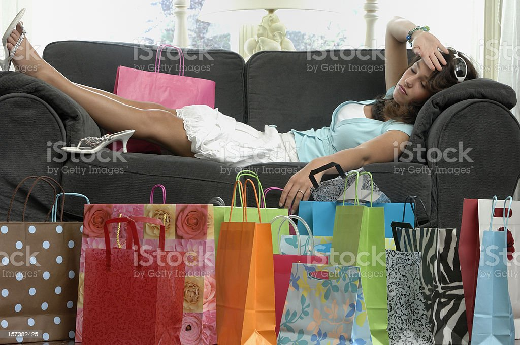 young woman tired after shopping stock photo
