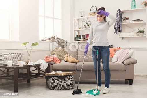 istock Young woman tired of spring cleaning house 953514698