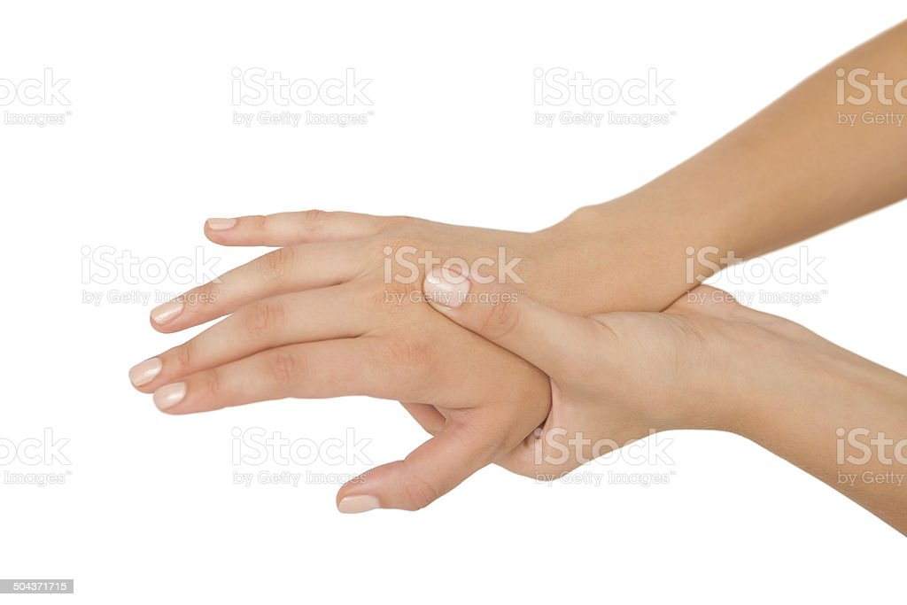 Young woman touching her injured hand stock photo