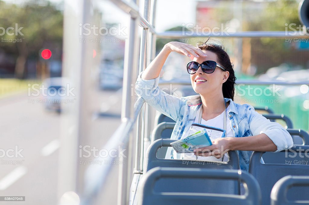 young woman touring the city on open top bus stock photo