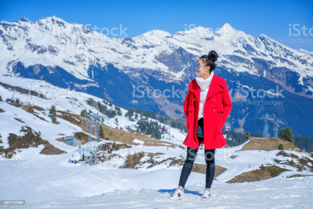 Young Woman Tourists see beautiful viewpoitn near Kleine Scheidegg station In daylight atI Switzerland stock photo