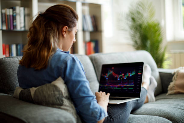 Young woman trading online stock photo
