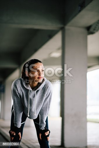Young woman running outdoors. Shallow DOF.