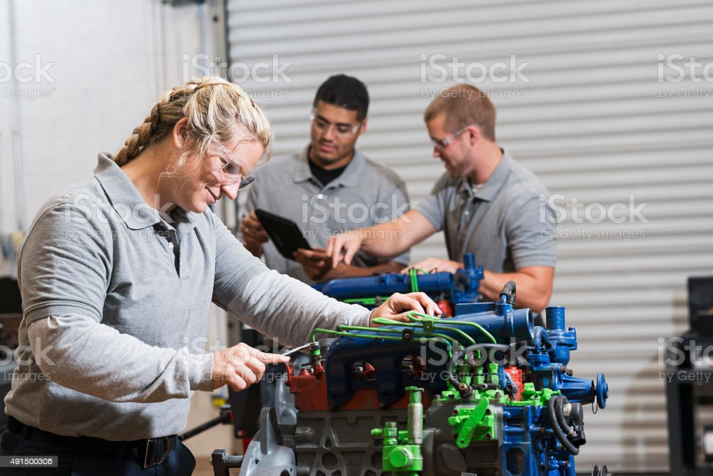 Young Woman Training To Be Auto Mechanic Stock Photo ...