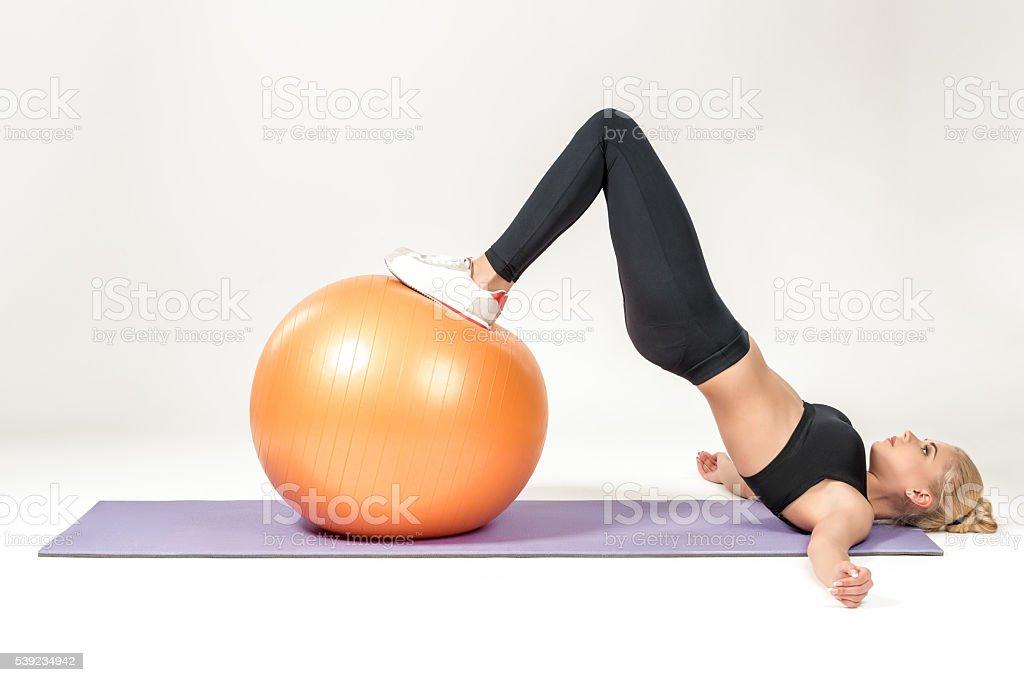 Young woman training with fitball royalty-free stock photo