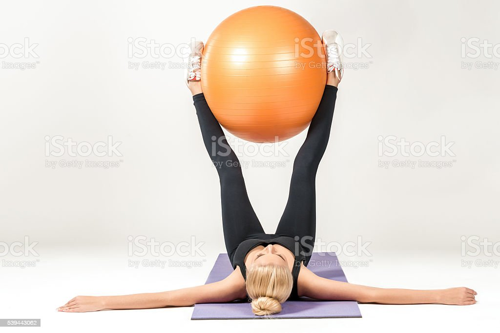 Young woman training with fitball stock photo