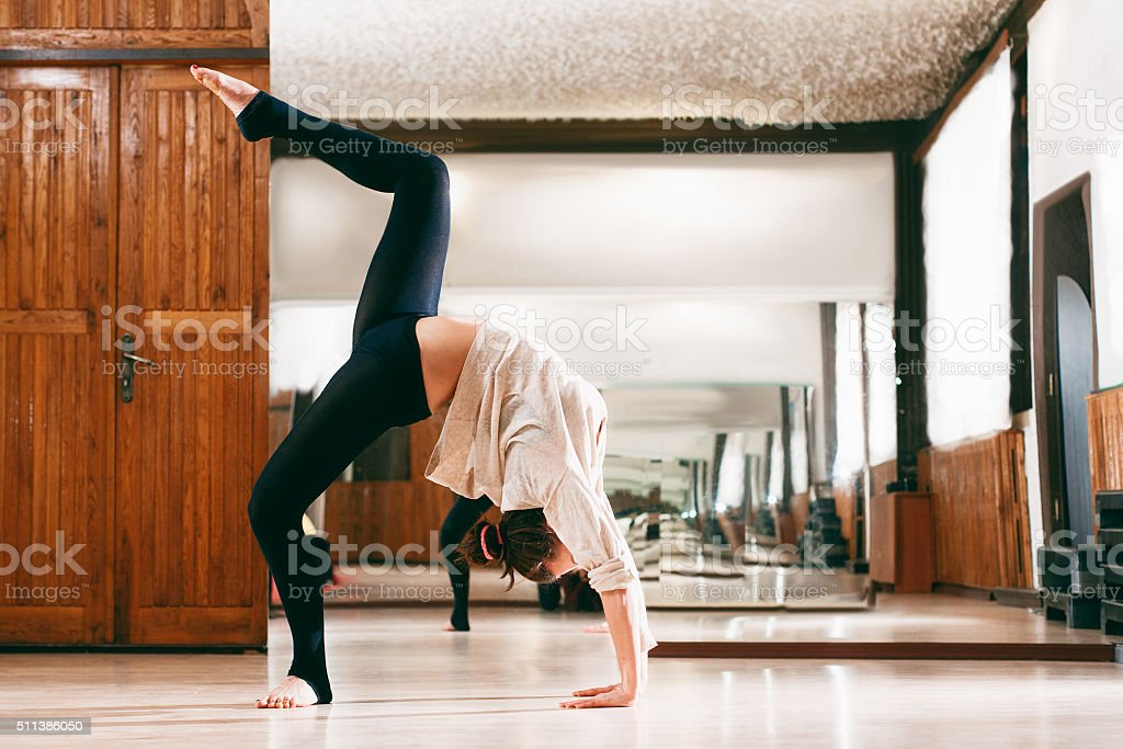 young woman trains the flexibility stock photo