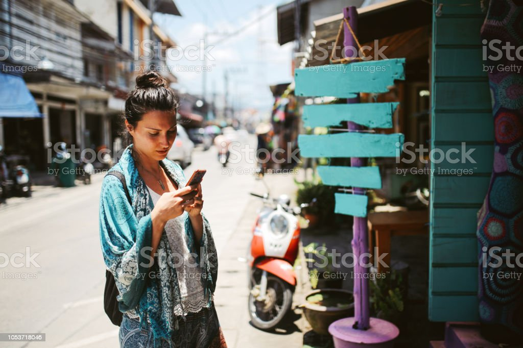 Young Woman Traveler Checking Smartphone Near Thailand