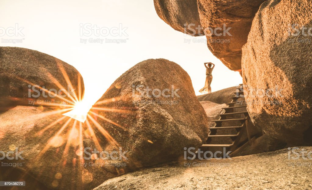 Young woman traveler enjoying peaceful sunset on Sailing Rock on Similan Islands - Wanderlust travel concept with adventure girl tourist wanderer on solo excursion in Thailand - Warm bright filter stock photo