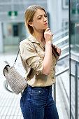 Young woman traveler looking at itinerary map at metro station
