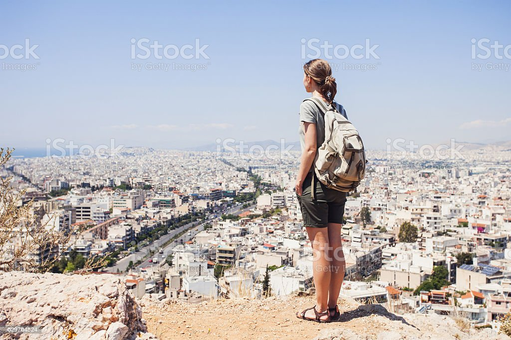 Young woman traveler looking on a city stock photo