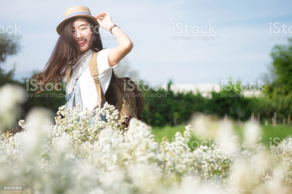 Young Woman Traveler with backpack relaxing outdoor. stock photo