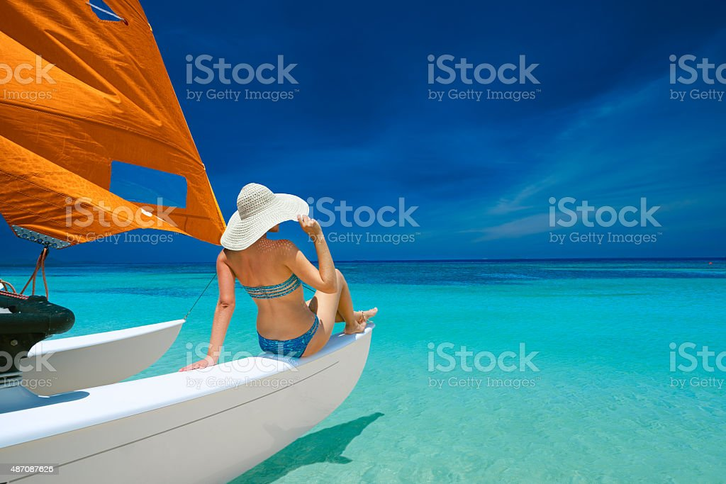 Young woman traveling by boat stock photo