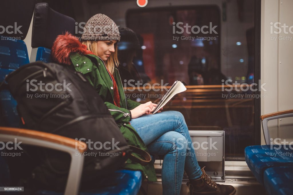 Young woman traveling by train in Germany stock photo