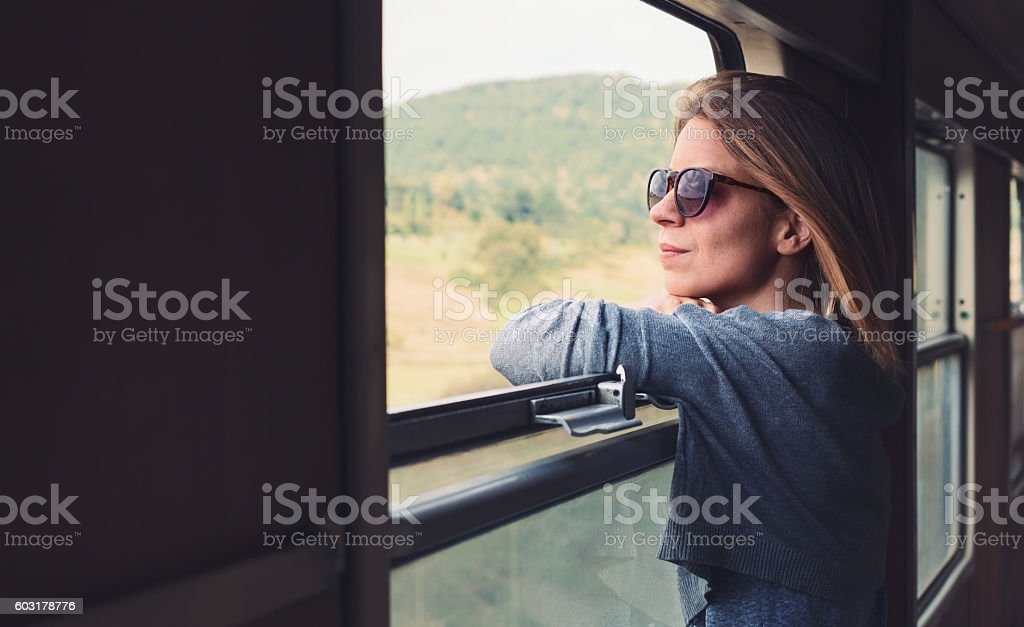 Young woman traveling by train stock photo