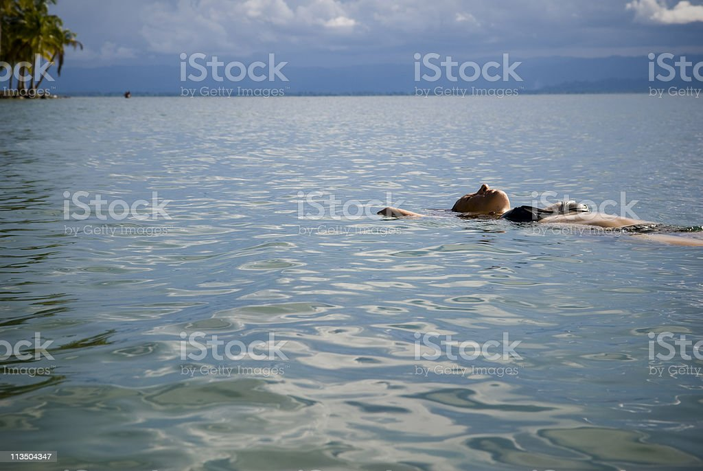 Woman Floating in Sea royalty-free stock photo