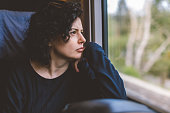 Young Woman Traveling In Train - Lost in thought