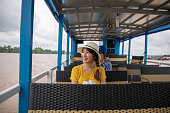 Young woman traveling Mekong River cruise