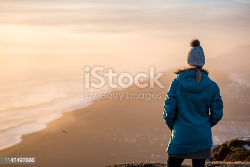 629376126istockphoto Young woman traveling solo in Iceland 1142492666