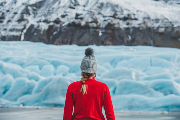 Young woman traveling solo in Iceland stock photo
