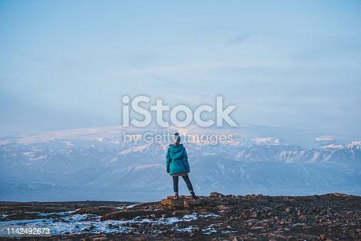 629376126istockphoto Young woman traveling solo in Iceland 1142492673