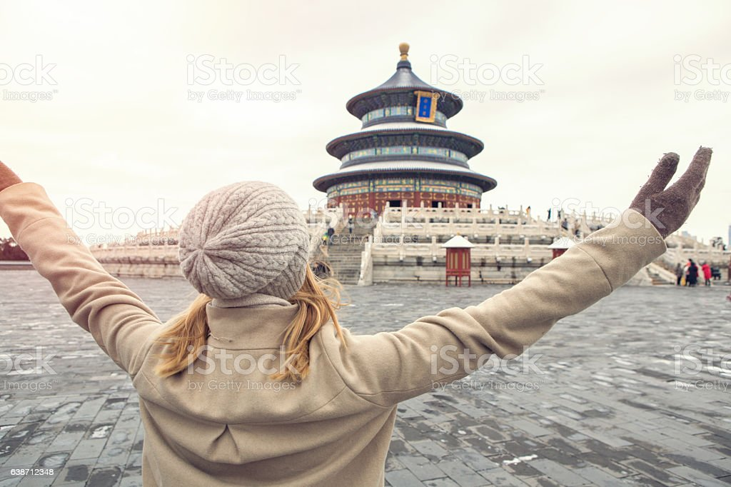 Young woman traveling stands arms outstretched, Beijing-China stock photo