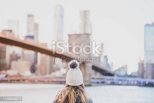 A young woman is traveling solo through New York City USA.