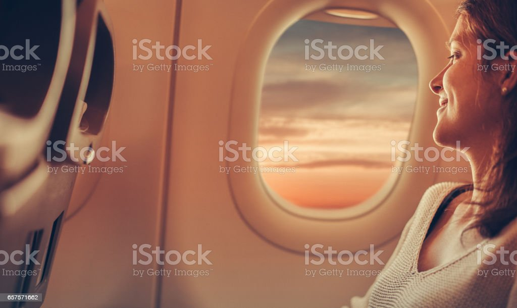 Young woman travelling with airplane stock photo