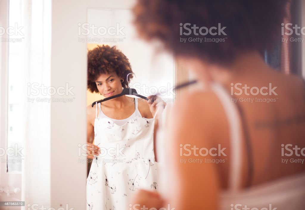Young woman trying on dress stock photo