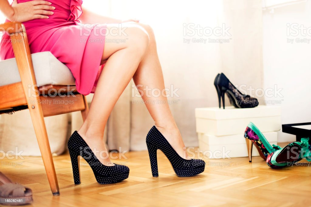 Young woman trying on shoes royalty-free stock photo