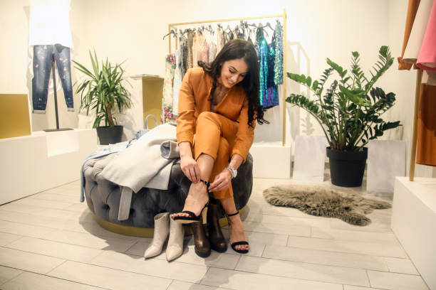Young woman trying shoes on stock photo