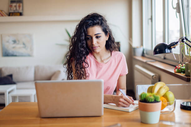 Young woman trying to find a job online stock photo