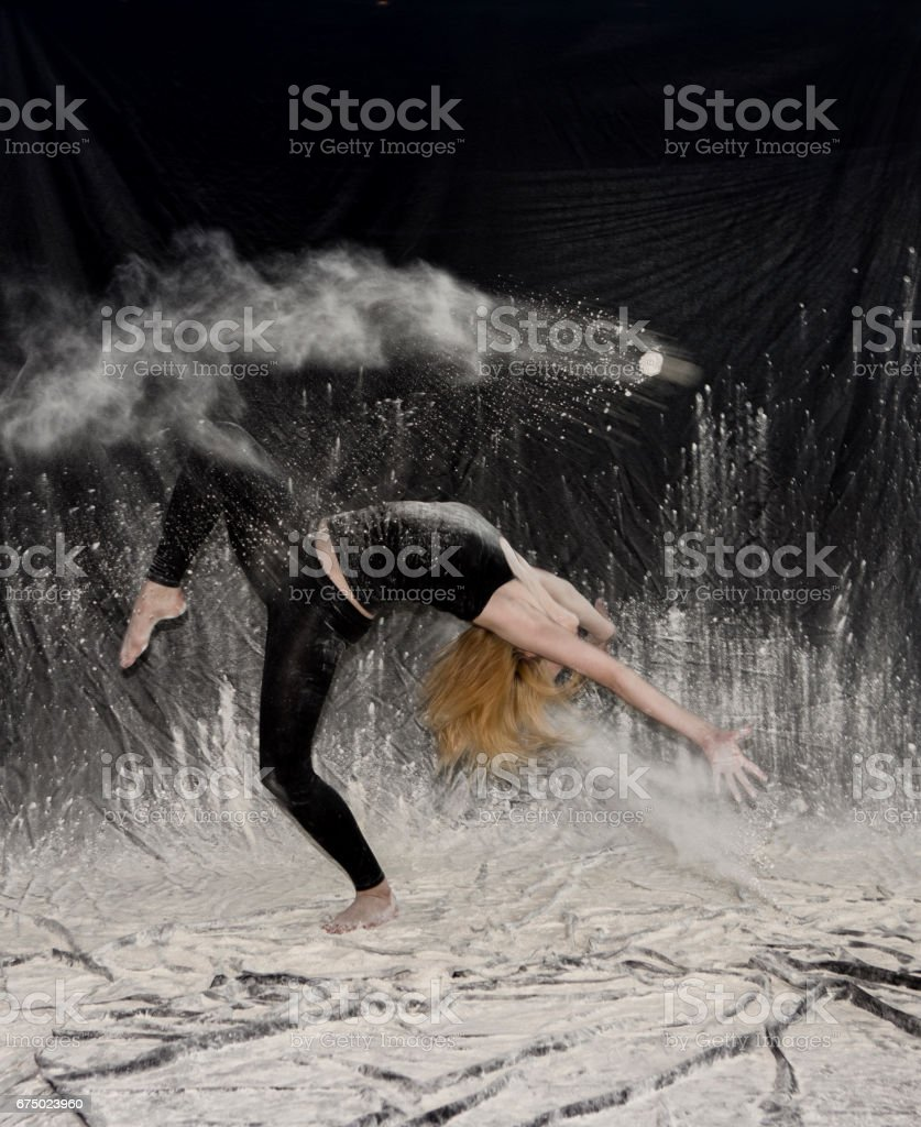 Young woman tumbling in dust and powder in studio at istanbul turkey stock photo