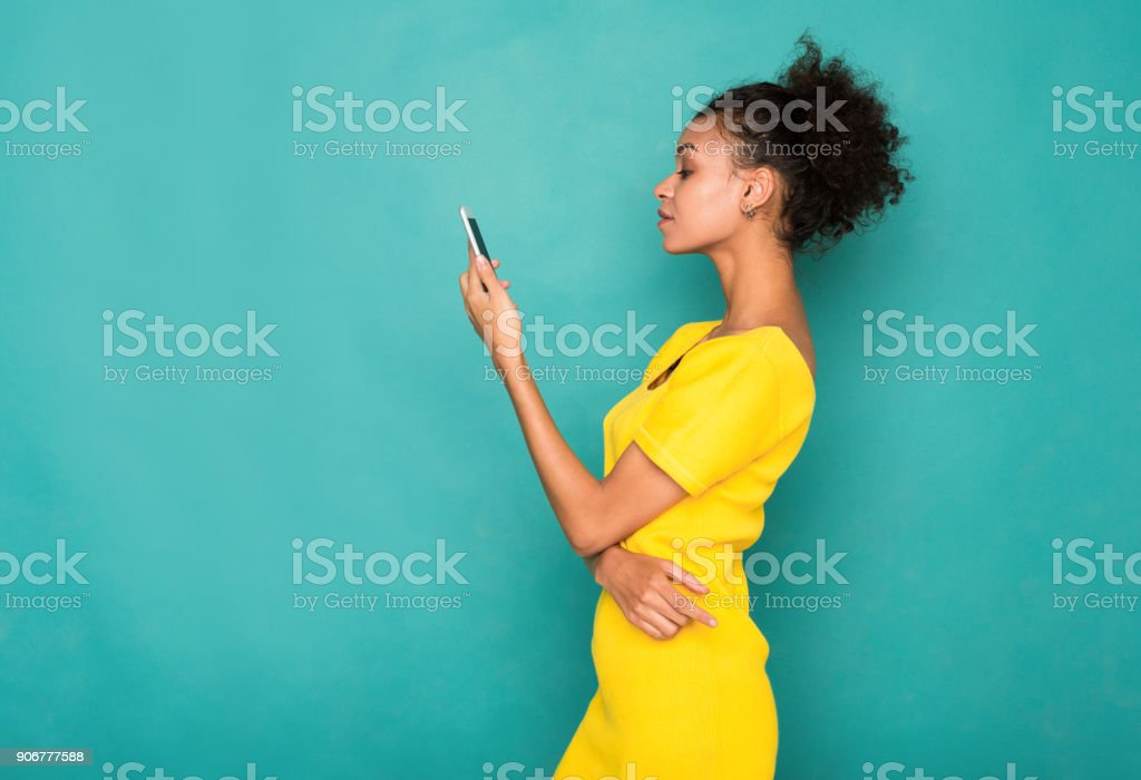 Young woman typing message on smartphone stock photo
