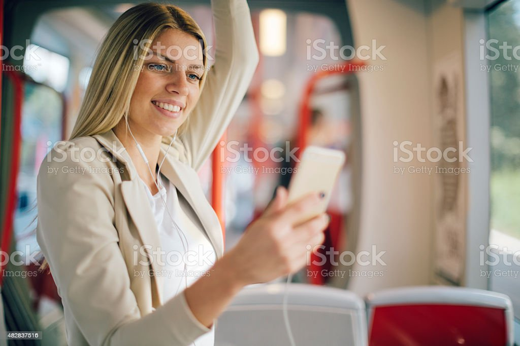 Young Woman Texting On Her Smart Phone In Public Transportation. She...