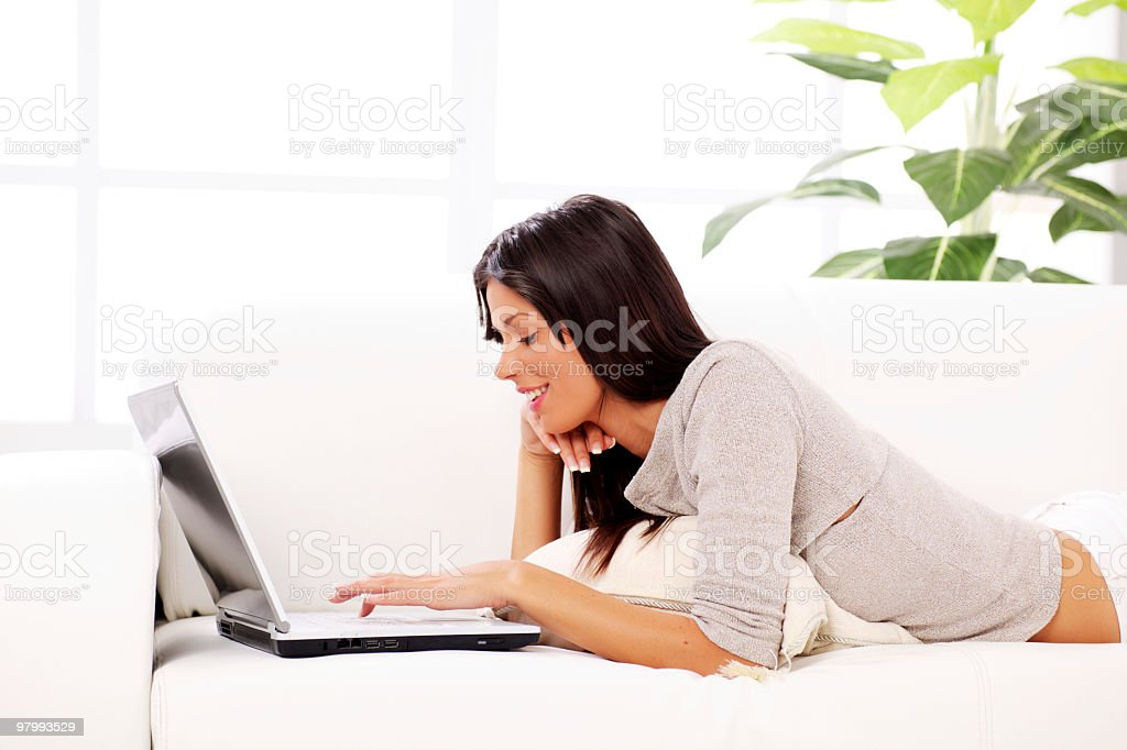 Young woman typing on laptop computer . royalty-free stock photo
